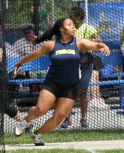 Webster Thomas' Monique Hardy competes in the discus throw during the New York State Track Championships in Middletown on June 7, 2019.