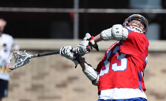Fairport's Klay Stuver winds up for a shot against Massapequa in the Class A title game.