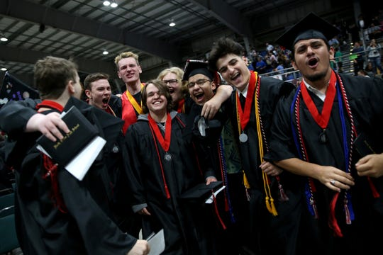 Graduates react to receiving their diplomas during the North Salem High School commencement at the Oregon State Fairgrounds in Salem on June 7, 2019.