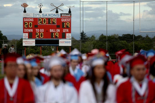 The scoreboard is lit up for 2019 as during the South Salem High School commencement at South Salem High School in Salem on June 7, 2019.