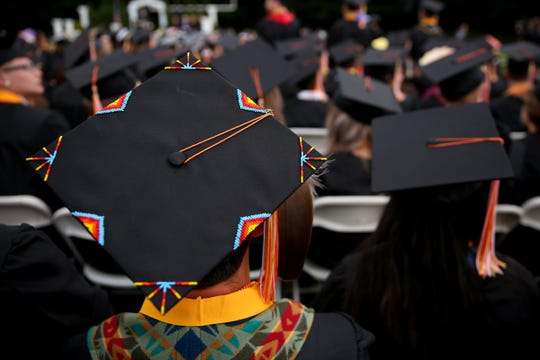 Graduate Tristin Liebelt wears a beaded cap in honor of his affiliation with the Confederated Tribes of Grand Ronde during the Sprague High School commencement at Sprague High School in Salem on June 7, 2019.