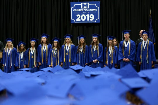McNary salutatorian and valedictorians are presented during the McNary High School commencement at the Oregon State Fairgrounds Pavilion in Salem on June 7, 2019.