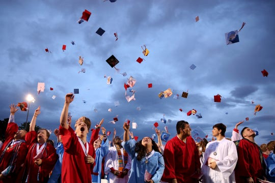 Graduates toss their caps following the South Salem High School commencement at South Salem High School in Salem on June 7, 2019.