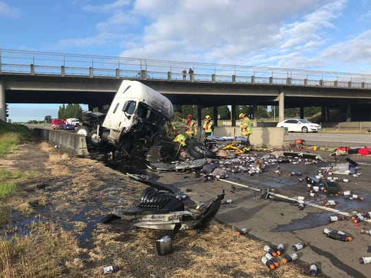 Gatorade bottles are strewn about Interstate 5, where a truck crash blocked two northbound lanes of traffic.