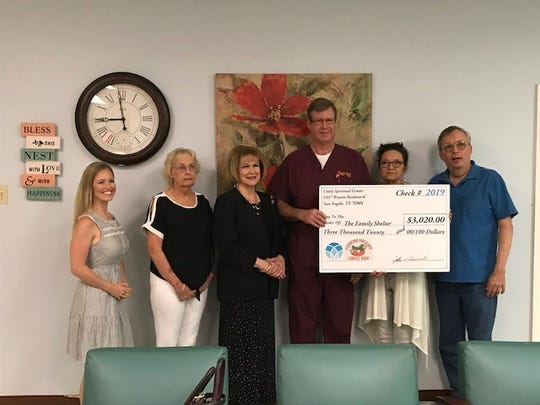 Unity Spiritual Center presented $3,020 to the Family Shelter last week with proceeds from their annual Chili Cookoff.     From left: Natalie Munoz; Janice Miller from the San Angelo Chili Pod; Rev. Janie Kelley, Senior Minister of Unity Spiritual Center; Jeff Greenwood, chairman of the church's Core Values team; Jeri Slone, executive director of the Family Shelter; and Jim Tufts, Board President at Unity.