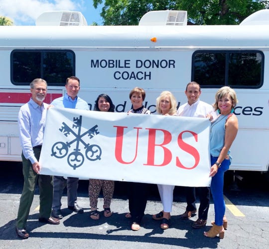 UBS Financial Services, Inc. and United Blood Services of San Angelo — now known as Vitalant – partnered for their ninth-annual Blood Drive and Hamburger Lunch.  Twenty donors donated 22 pints of blood, saving the lives of 66 hospital patients.  Pictured from left to right are Lee Horton, Dee Jay Wilde, Susan Scoggin, Julie Kasberg, Bridget Doyle, Ryan Barnes and Ruth Wilde.  In September of 2018, Lifeblood, Blood Centers of the Pacific, BloodSource, Bonfils Blood Center, Central Blood Bank, Community Blood Services, Inland Northwest Blood Center, LifeShare, LifeSource, and United Blood Services merged as Vitalant.