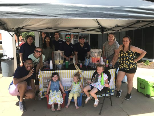 Harley Ratliff and her friends and family help FOX West Texas and the Standard-Times raise money for NOAA radios with a lemonade stand at 5 S. Chadbourne St. Saturday, June 8, 2019.
