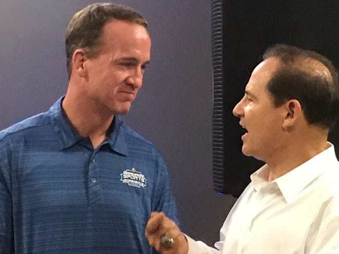 Peyton Manning and Les Miles share a moment during the 2019 Louisiana Sports Hall of Fame induction weekend in Natchitoches.