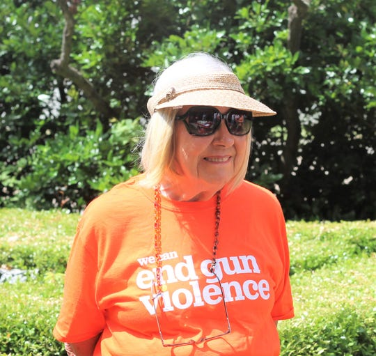 Moms Demand Action for Gun Sense gathered at Holy Cross Church downtown for a Wear Orange event
