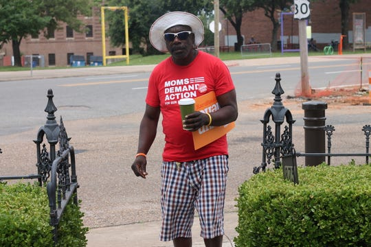 Man wearing Moms Demand Action for Gun Sense t-shirt at Wear Orange event in downtown Shreveport
