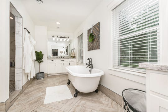 Michelle says they stole space from the laundry room to create a larger master bath with a walk-in shower and freestanding claw-foot bubble massage bath.