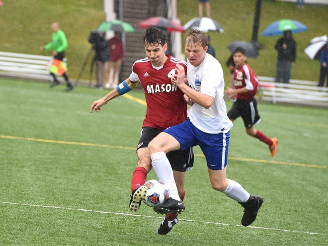 Thomas Otteni battles a Mason player for the ball during Lee High's 2-0 win over George Mason for the VHSL Class 2 boys soccer state championship Saturday.
