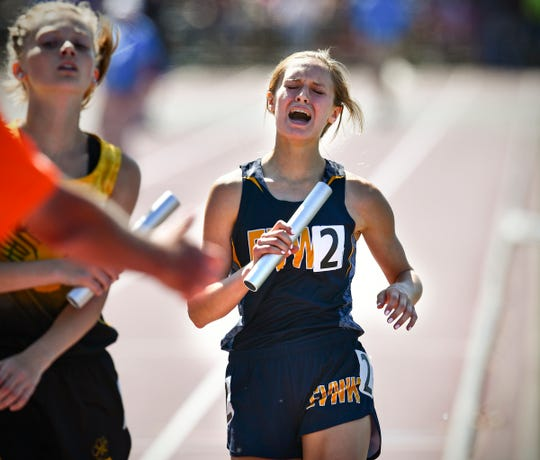 Ellie Kuechle of Eden Valley-Watkins/Kimball crosses the finish line of the 4x800 meter relay during the state Class A track meet Saturday, June 8, at Hamline University in St. Paul.