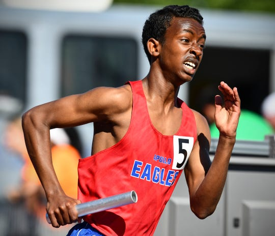 Liban Mohamed completes the second leg of the 4x800 relay for Apollo during the state Class AA track meet Saturday, June 8, at Hamline University in St. Paul.