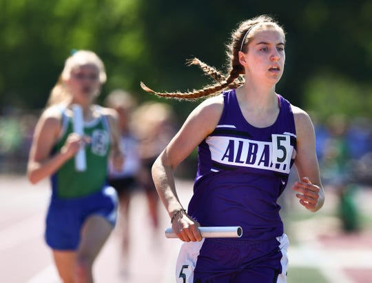 Kristine Kalthoff competes for Albany in the 4x800 meter relay during the state Class A track meet Saturday, June 8, at Hamline University in St. Paul.