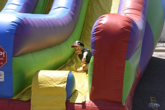 A child goes down a slide June 8 during the Sartell SummerFest.
