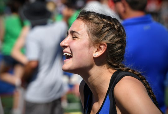 Isabelle Albers of Foley smiles while talking about her school record-breaking vault during the state Class AA track meet Saturday, June 8, at Hamline University in St. Paul.