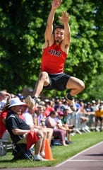 Matthias Algarin of Pierz competes in the long jump during the state Class A track meet Saturday, June 8, at Hamline University in St. Paul.
