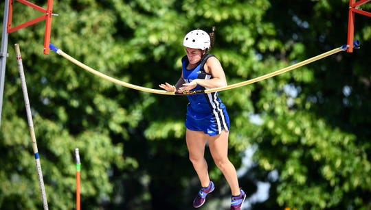 The bar bends but does not fall as Isabelle Albers of Foley clears 11 feet, 6 inches during the state Class AA track meet Saturday, June 8, at Hamline University in St. Paul. The vault was a new school record.