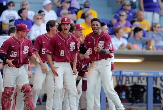 The Florida State bench celebrates Reese Albert's tying 3-run homer against LSU in the seventh inning of Game 1 of the NCAA college baseball super regional tournament in Baton Rouge, La., Saturday, June 8, 2019. (AP Photo/Gerald Herbert)