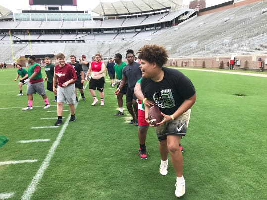 Caelen Cotten of The Villages Charter School catches an interception playing Nole Ball with the offensive and defensive linemen at Florida State on Saturday, June 8, 2019.