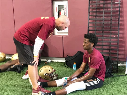 Florida High School head coach Jarrod Hickman talks with Willie Taggart, Jr. after a 7 on 7 game on Saturday, June 8, 2019.
