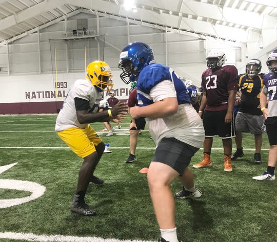 Arin Clay of Rickards High School (left) goes one-on-one with Owen Henderson of Model High School from Rome, Georgia at the Willie Taggart Big Man Camp on Friday, June 7, 2019.