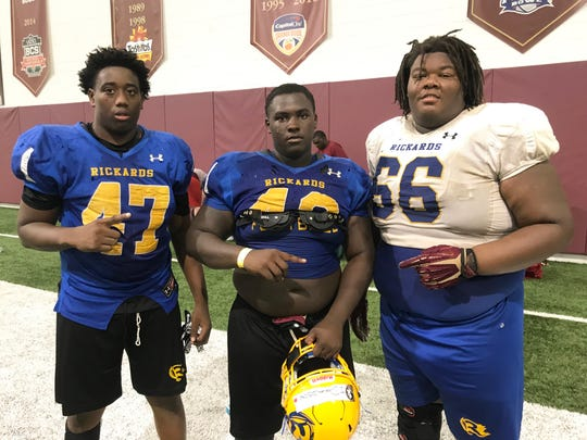 From left to right: Rickards High School players Akari David, Jonathyn Donaldson  and Darius Glee gained deep insight on playing in the trenches at the Big Man Camp at Florida State.