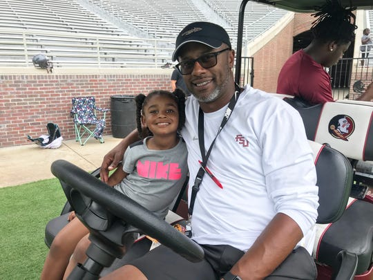 Florida State football head coach Willie Taggart poses with his daughter Morgan during the Big Man Camp on Saturday, June 8, 2019.