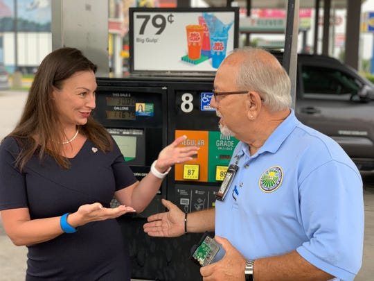 Florida Agriculture and Consumer Services Commissioner Nikki Fried and Inspector Joe Scobbo discuss gas pump skimmers at a 7-Eleven in Orlando Saturday.