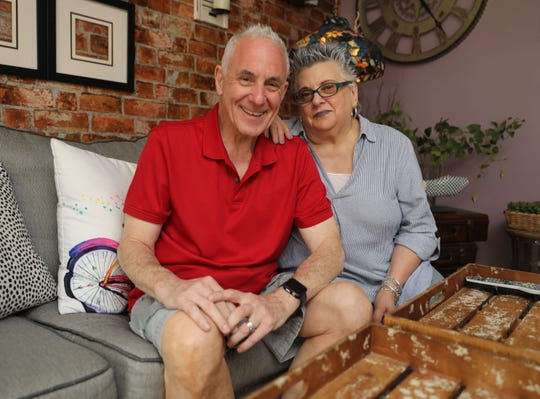 """Kevin McKenna and his wife Diane, are pictured in their home in Dobbs Ferry, June 8, 2019. Kevin, the on-set medic for the show """"The Blacklist,"""" saved his wife when she started choking, the first of five lives he's saved."""