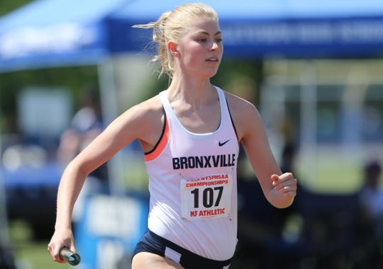 Bronxville's Caroline Brashear runs a leg of the 4x800-meter relay at the NYSPHSAA Track & Field Championships ar Middletown High School in  Middletown on Saturday, June 8, 2019.