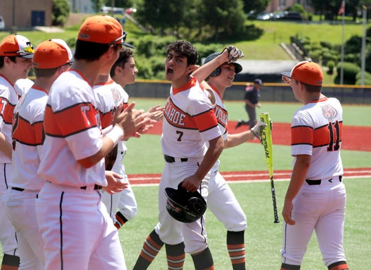Tuckahoe's Justin Lee is greeted at home after scoring a run against Pierson, during their Class C state regional baseball game at Pace University in Pleasantville, June 8, 2019.