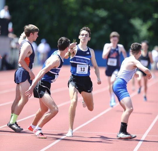 Bronxville's Alex Rizzo hands off to brother Matt Rizzo in the 4x800-meter relay at the NYSPHSAA Track & Field Championships ar Middletown High School in  Middletown on Saturday, June 8, 2019.