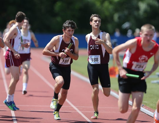 Scarsdale's Daniel Asher hands off to David Matusz in the 4x800-meter relay at the NYSPHSAA Track & Field Championships ar Middletown High School in Middletown on Saturday, June 8, 2019.