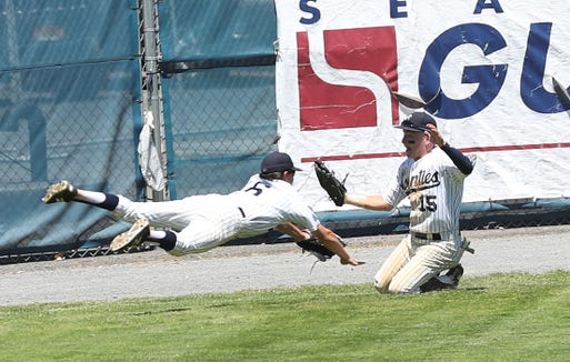 Suffern's Colby Brenner (6) and Wyatt Palmer (15) dive for a triple hit By Kingston's Jake McNutt that drove in 2 runs in the 5th inning during the Class AA state regional final game at Cantine Field in Saugerties, NY June 8, 2019.