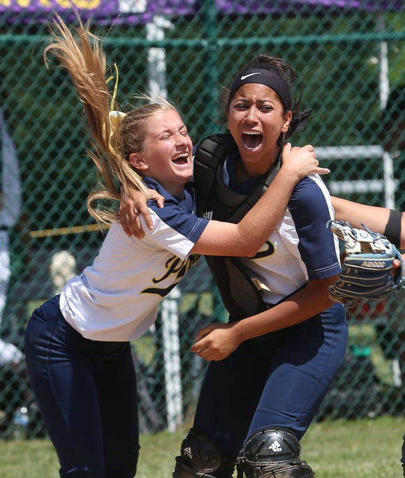 From left, Walter Panas pitcher Olivia Bordenaro and catcher Kat Reynoso celebrate after defeating Minisink Valley 2-0 in the regional final at Rhienbeck High School June 8, 2019.