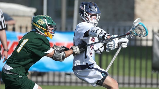 Briarcliff's Matthew Waterhouse tries to shed the defense by LaFayette's Jason Holbrook.