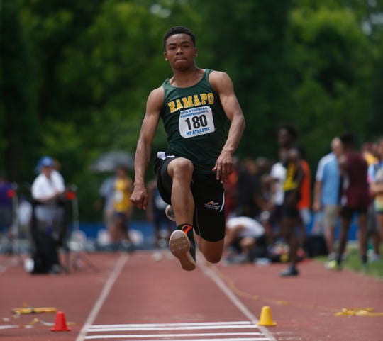 Ramapo's Chris Fils competes in the triple jump during the New York State Track Championships in Middletown on June 7, 2019.