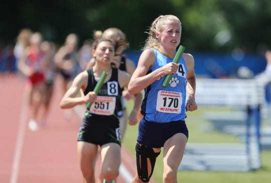 Ursuline's Lily Flynn runs a leg of the 4x800-meter relay at the NYSPHSAA Track & Field Championships ar Middletown High School in  Middletown on Saturday, June 8, 2019.