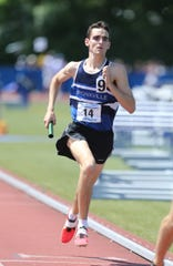 Bronxville's Matt Rizzo runs a leg in the 4x800-meter relay at the NYSPHSAA Track & Field Championships ar Middletown High School in  Middletown on Saturday, June 8, 2019.