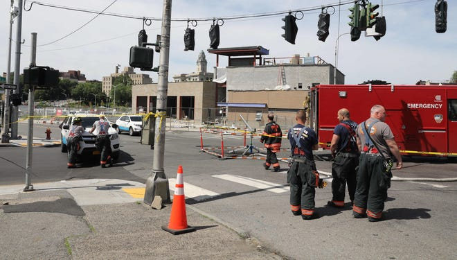 Yonkers firefighters and Con Edison workers at the scene of a manhole fire on New School Street and Palisade Avenue on Saturday, June 8, 2019.