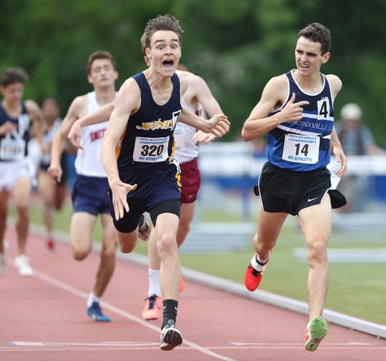 From left, Faith Heritage's Hans Matzal crosses the finish line ahead of Bronxville's Matt Rizzo in the 800 Meter Run during the New York State Track Championships in Middletown on June 7, 2019.