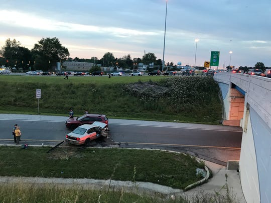 Delaware River and Bay Authority Police investigate after a car plunged over an embankment and struck a car on the ramp from I-295 southbound to U.S. 13 southbound Friday evening.
