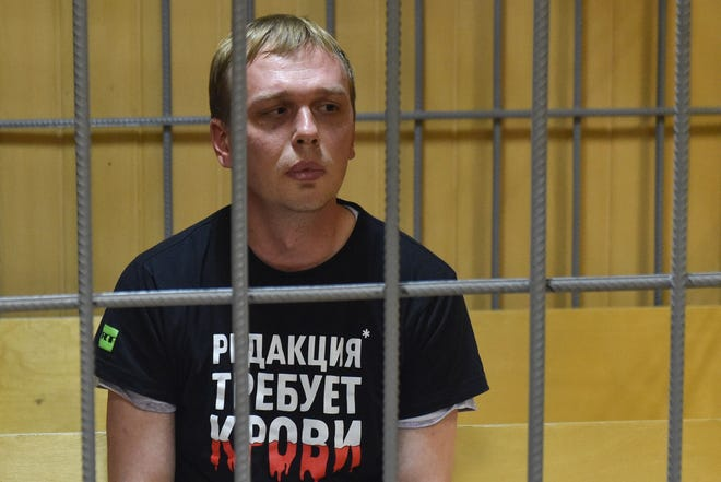 Russian investigative journalist Ivan Golunov, charged with attempted drug-dealing, sits inside a defendants' cage during a hearing at a court in Moscow on June 8, 2019.