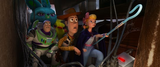 "Buzz (voiced by Tim Allen, far left), Bunny (Jordan Peele), Ducky (Keegan-Michael Key), Woody (Tom Hanks) and Bo Peep (Annie Potts) are on a rescue mission in ""Toy Story 4."""