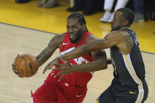 Kawhi Leonard drives to the basket while Andre Iguodala defends during the first quarter of Game 4 of the NBA Finals.
