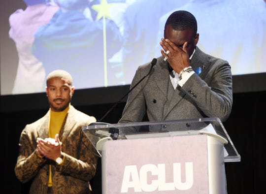 Honoree Yusef Salaam, right, becomes emotional at the podium as presenter Michael B. Jordan looks on at the ACLU SoCal's 25th Annual Luncheon at the JW Marriott at LA Live, Friday, June 7, 2019, in Los Angeles.