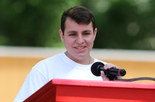 17-year-old cancer survivor Johnny Volpe speaks about his treatment at Six Flags Great Adventure Sunday.