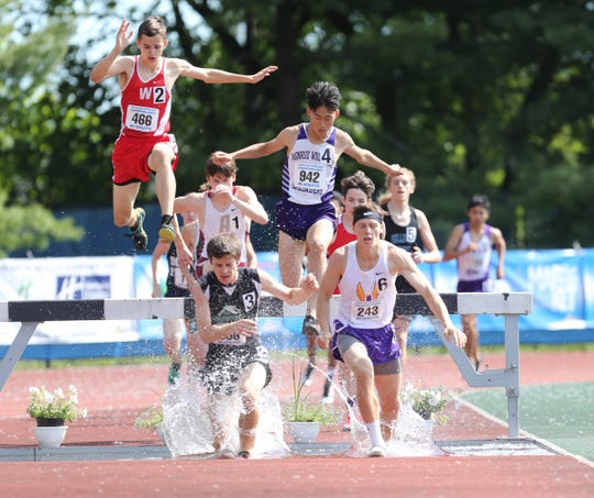 Waverly's Collin Wright competes in the 3000-meter steeple chase at the NYSPHSAA Track & Field Championships ar Middletown High School in Middletown on Saturday, June 8, 2019.